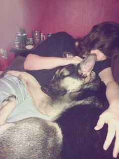 Dogs are very loyal and know when you are not feeling well! This is me and my German Shepherd after I got home from the ER. She knew I wasn't feeling good so she was my blanket. <3 My husband snagged this photo while I was sleepin. lol