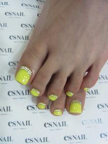Bright neon yellow toenails
