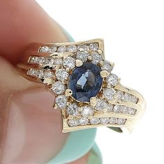 1.06 ct NATURAL OVAL BLUE SAPPHIRE AND ROUND CUT DIAMOND RING 18K YELLOW GOLD