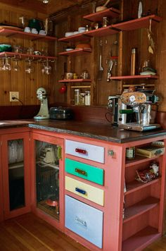 Fun, colorful kitchen from reclaimed cabin. This could easily be a DIY!