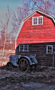 Red Barn With Tractor In Front   ..rh