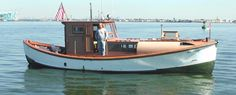 """This trawler began life as a 1929 Coast Guard 36 ft. motor lifeboat, or as the owner describes, a """"rollover lifeboat"""". Notice the hull lines, the reserve bouyancy for self righting. Notice the sugarscoop stern swim platform, and the cutaway transom for the outboard. The owner has had this boat for 35 years, I think he likes it."""