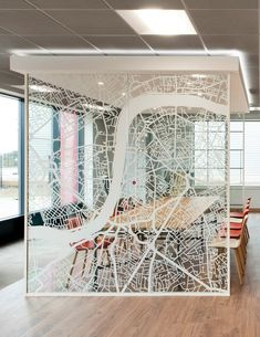 Office design inspiration >> Wall art >> This transparent partition wall is decorated with a map of the Thames, the area around Lambeth where Costa Coffee's old offices used to be. The heritage of the brand including their South London roots were important throughout their new office design and new purpose built facility in Essex. See more in the case study on our website: