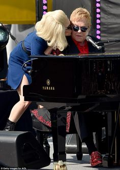 Sweet smooch: Lady Gaga planted a kiss on Elton John as they performed afree surprise con...