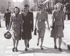 These all women were wearing Victory Suits, known as two pieces ulility suit. This style indicated early 1940s rational: saving, useful,comfort and needed to remake from old clothes or materials, because they could mix and match around skirts, blouses, jackets for a new outfit everyday. The skirts were A-line with no pleats or gather for wasting fabric