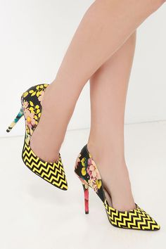 Don't be shy, slip on the Chinese Laundry Stilo Yelllow Floral D'Orsay Pumps and experience what the luxe life is all about! Black and yellow printed faux leather sculpts a sassy pointed toe upper that greets a D'Orsay vamp. Floral print heel cup.