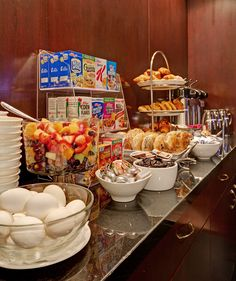 The Library hotel's complimentary continental breakfast buffet: hard boiled eggs, yogurts, hot oatmeal, a selection of cold cereals, assorted Danish, scones, muffins and bagels, butter, cream cheese, peanut butter and jams, fresh whole fruits and fruit salad, a selection of international coffees, teas and juices. Soy milk and gluten free options are available on request. #ContinentalBreakfast #LibraryHotel