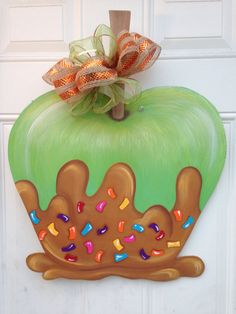 Woodworking Jigsaw Wooden Caramel Apple with Sprinkles Door Hanger - This cute caramel apple will make your door stand out from all the rest! It measures It is hand cut out of wood, then hand painted. It is hung with wire and topped with a bow. Painted Doors, Wooden Doors, Painted Signs, Hand Painted, Burlap Door Hangers, Fall Door Hangers, Plant Hangers, Wooden Hangers, Fall Crafts