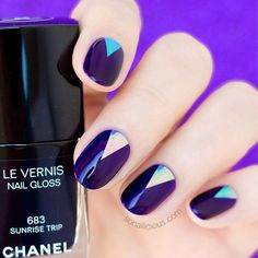 Deep Blue Oval Nail Design With Triangle Accent #deepbluenailscolor Explore cute designs for short and long oval nails. Whether your nails are natural or acrylic, learning how to shape your nails oval is worth it. #naildesigns #ovalnails #nailart #nails