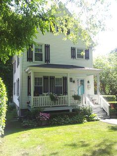 White house, black shutters, turquoise door, flowers!!!!
