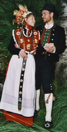 At a wedding, the bride's Bunad is dressed up by adding a silver or silver and gold crown. Dangling around the crown there are small spoon-shaped bangles. When the bride moves her head the bangles produce a melodic tinkling. Norwegian tradition holds that the music from the bride's bangles will ward off evil spirits.