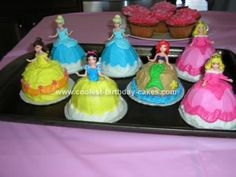 These are disney princess cupcakes I made for my nieces birthday. I used regular cupcakes turned upside down. I put a little frosting on the cardboard