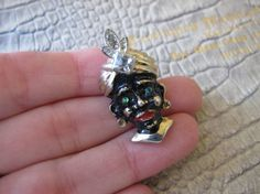 BLACKAMOOR Costume Collectible Fashion Brooch Pin. Gold Tone, Clear Cut Crystals & Cabochon Emerald-Green Stone Figural African Man Brooch