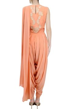 Amrita KM presents Peach draped dhoti saree with peach thread embroidered bodysuit available only at Pernia's Pop Up Shop. Indian Gowns Dresses, Pakistani Dresses, Indian Outfits, Wedding Saree Blouse Designs, Kurti Designs Party Wear, Ethnic Trends, Dhoti Saree, Drape Gowns, Kids Frocks Design