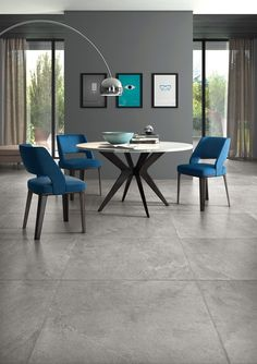 Cool and trendy dining room idea, featuring curved floor lamp and slate effect floor tiles. Living Room Tiles, Grey Flooring, Tile Design, Floor Tile Design, Flooring, Floor Lamp Design, Room Tiles Design, Living Room Designs, Industrial Style Decor