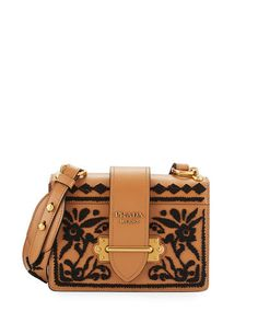 "Prada embroidered smooth calfskin shoulder bag. Bronze-finish hardware. Adjustable shoulder strap, 18.5"" drop. Flap top with buckle closure. Metal logo lettering on flap. Interior, one flap and one sl"