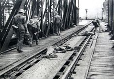June 22, 1941: On the first day of Operation Barbarossa, German troops of 101 Division cross the bridge at the Polish city of Przemysl and suffer the very first casualties of the conflict with Russia. Note the soldier in the foreground who stares at his dead comrade lying between the railroad tracks.