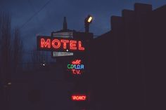 Neon motel sign at dusk in Portland, OR