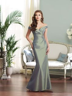 Off-the-shoulder taffeta slim A-line gown with sweetheart neckline, directionally draped Empire bodice with back zipper, side draped skirt. Available in all taffeta colors. Color shown: Sage Sizes: 0 – 28