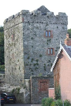 Strangford Castle is a castle on a height overlooking the harbour in Strangford, County Down, Northern Ireland, across Strangford Lough from Portaferry Castle. It wa probably originally built in the 15th century but most of the present building dates from the late 16th century.