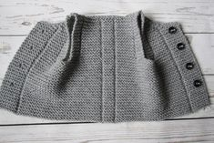 Best 11 This baby vest is made from of wool, acrylic yarn. It features four buttons for closure The waistcoat is warm, cosily soft and comfortably lightweight. Pictured color: gray Please select desired color and size. Made to order. The baby vest Baby Knitting Patterns, Baby Patterns, Baby Outfits, Toddler Outfits, Baby Pullover, Easy Knitting, Baby Booties, Baby Hats, Creations