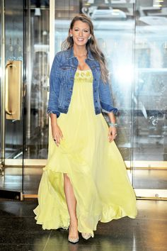 Blake Lively in a strapless sunflower yellow maxi dress with embellished bust and all-American denim jacket.