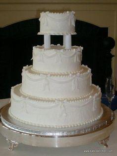 Wedding Cakes- 4 tier, buttercream, white, pillars, bows with draping ribbon