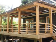 Garden & Patio, Solid Wood Horizontal Deck With Big Wood Pillars And Stairs ~ Horizontal Deck Railing:  The Advantages and Disadvantages