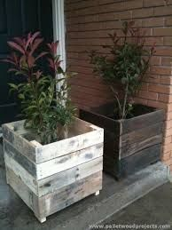 Awesome plant boxes made from used pallet wood. The one on the right was sanded and sealed with a clear-coat, the left one was sanded then stained.