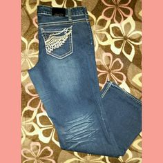 ZCOJEANS PREMIUM Dark denim jeans. Faded behind the knees. Fancy designs on the back pockets. Very cute!!! ZCOJEANS PREMIUM  Jeans Flare & Wide Leg