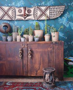 photo by @apartmentf15 - cactus and succulent kind of a day and my african bwa butterfly mask found a perfect spot on #ajawallpaper by @justinablakeney for @hyggeandwest