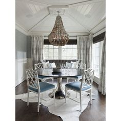 dining rooms - white faux bamboo chairs white cowhide rug blue damask wallapper white chair rail beadboard shells chandelier Glossy white beadboard found on Polyvore