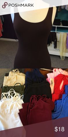 Spaghetti Strap and Thick Strap Tank Tops Solid colored tank tops. 92% Nylon, 8% Spandex. Brand new but no tags Nikibiki Tops Tank Tops
