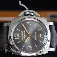 A base dial that's not so simple.  The #Panerai PAM605 47mm Luminor featuring the Grey sun brushed dial and gold hands. www.PaneraiCentral.com
