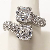 """Katya Asscher with Pave Cubic Zirconia Bypass Ring, 3.7 Ct TW by Mystique... Katya is a perfect """"Right Hand Ring"""", with a wow factor! Starring two 1.5 carat each Asscher cubic zirconia stones in a pave bypass setting, Katya is approximately 3.7 carats total weight and 5/8 inches (16.0mm) at the widest point on the top of your finger. Available in 14K white gold or 14K yellow gold. Model: 7517A3, $1,295.00"""