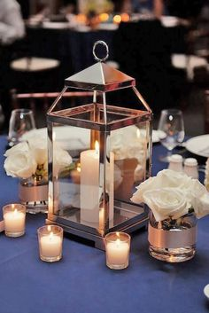 Vintage lantern wedding centerpiece surrounded by white 42 amazing lantern wedding centerpiece ideas junglespirit Image collections