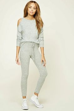 A pair of brushed marled knit sweatpants featuring an elasticized waistband and a mock drawstring waist.