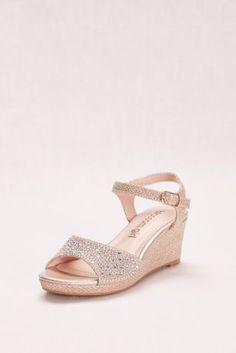 """Ideal for junior bridesmaids, these sparkling party shoes combine our three favorite things: glitter, crystals, and comfort.  By Blossom Girl  Synthetic  1 1/2"""" heel  Adjustable buckle  Imported"""