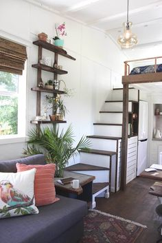 Handcrafted Tiny House, view of stairs, storage and fridge.