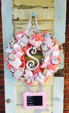 A personal favorite from my Etsy shop https://www.etsy.com/listing/466339062/baby-girl-pink-and-gray-hospital-door