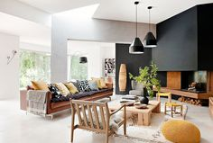 Black walls in the living room with leather sofa