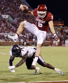 Oklahoma's Baker Mayfield  leaps for a touchdown during the second half of a college football game between the University of Oklahoma Sooners (OU) and the Akron Zips at Gaylord Family-Oklahoma Memorial Stadium in Norman, Okla., on Saturday, Sept. 5, 2015. Photo by Steve Sisney, The Oklahoman