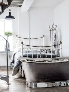 A luxurious bath before bed is one of our favourite combinations. Pictured is the Nickel Bateau bath by Catchpole and Rye.