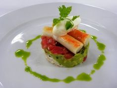 Napoleon of King Crab and Ahi Tuna _ Taste the treasures of the sea at home with this recipe from the Seabourn kitchen. Fresh King crab and Ahi tuna tartare are paired with a spicy avocado salad and topped with a Yuzu sherbet for an elegant, healthy dish.