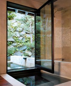 """In the master bedroom, a custom concrete Japanese soaking tub abuts an outdoor pool, giving Dow the sense of soaking in the garden; a sheet of glass divides the tub from the adjoining shower."" From Met Home 08, 'The Tao of Dow.'"