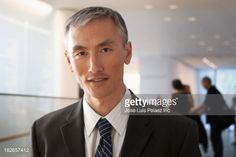 Chinese Businessman Smiling Stock Photo   Getty Images