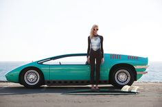 Alicia Kuczman shot in front of a 1968 Bizzarini Manta by ItalDesign for 'Endless Summer'-surfwear campaign of the Brazilian luxury brand Osklen by Brazilian photographer Vavá Ribeiro.