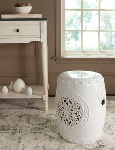 "$119 - White ceramic medaion garden stool with embossed Chinese vessel nailheads 15""D x 17""H"