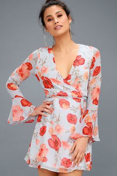 You deserve to be recognized for your impeccable sense of style, so we present you with the Petal of Honor Light Blue Floral Print Wrap Dress! A cheerful floral print, in shades of coral orange, decorates dreamy chiffon that falls into long, sheer flounce sleeves, a wrapping bodice, and an adjustable waist with tying sash belt and internal ties. Lightly flared skirt falls to a flirty hem.