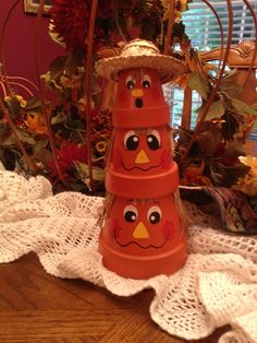 Three terra cotta pot pumpkins:)